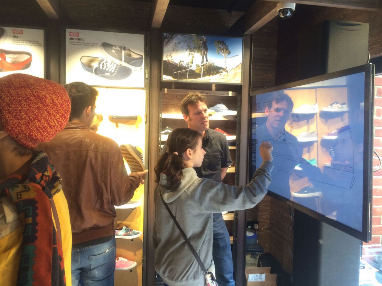Air Graffiti Touch, Interactive Digital Surface: A shopper custom coloring a shoe @ a Vans store