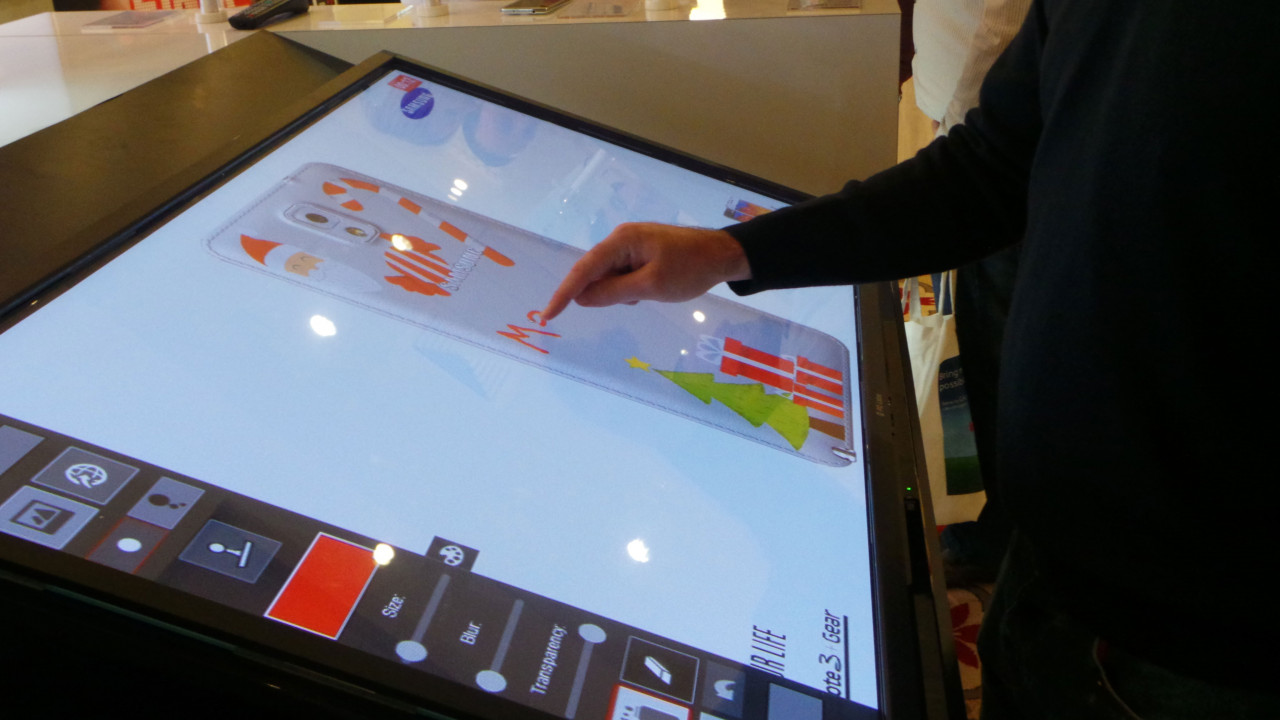 Air Graffiti Touch, Interactive Digital Surface: A guest designing his own smartphone cover @ a Samsung event