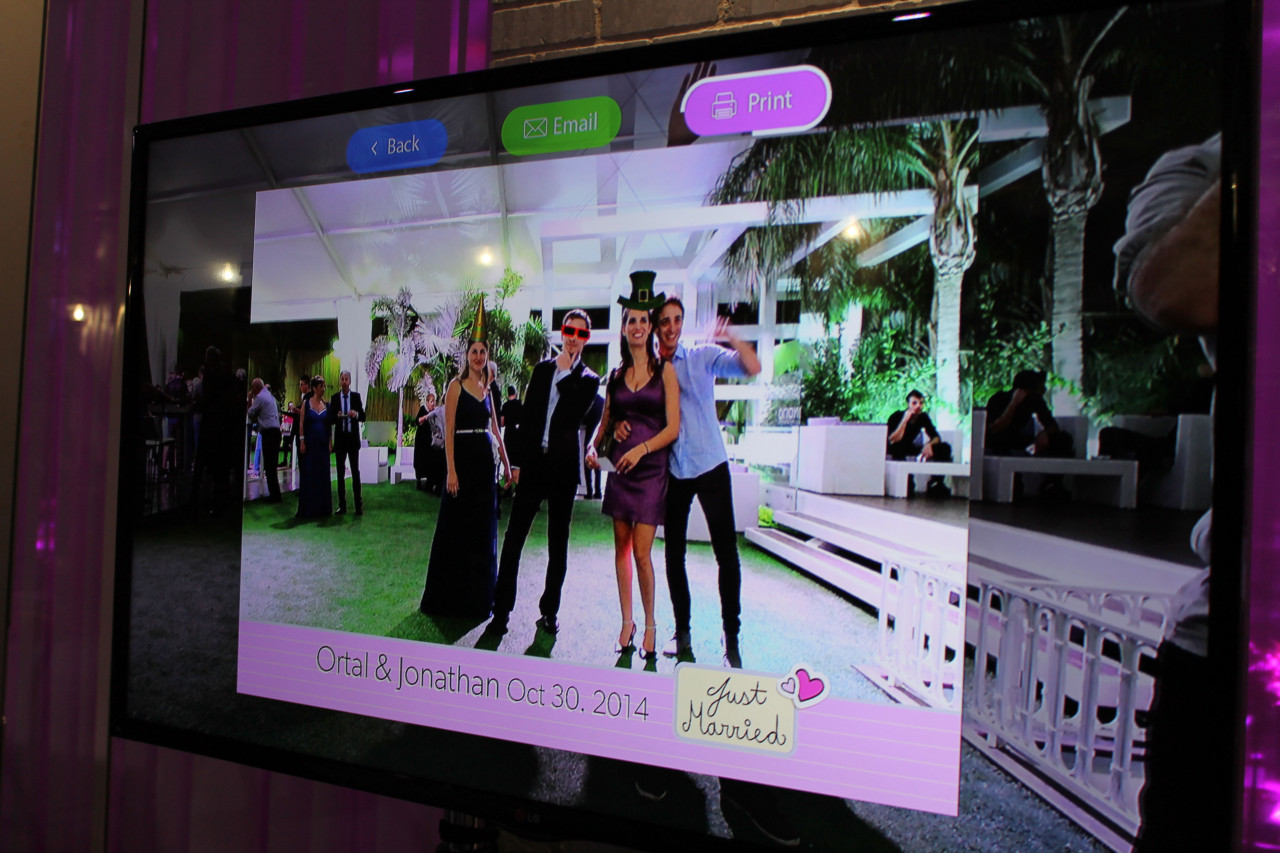 Augmented Reality Photo Booth: A Selfie of Wedding Guests Featuring Different Built-In 3D Props
