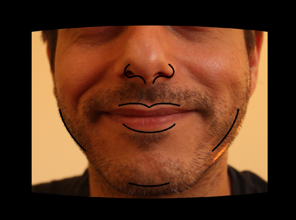Screenshot from the Foto Master Photo Booth software of a man positioning his face according to an outline appearing on the screen in order to get the correct area of his face printed on the mask