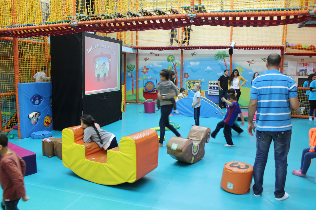 Interactive Story: Kids Having Fun at a Family Entertainment Center